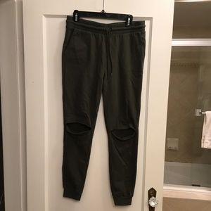 Green joggers with knee slit